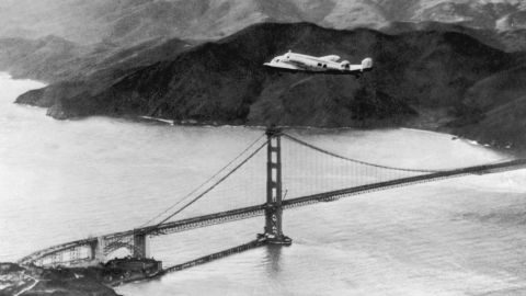 The Lockheed Electra 'Flying Laboratory' piloted by Earhart and Fred Noonan flies over the Golden Gate bridge in Oakland, California, at the start of a planned around-the-world flight on March 17, 1937. The trip had to be abandoned after the plane crashed on takeoff in Hawaii.