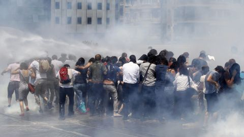 Riot police use tear gas and water cannons to disperse a crowd at Taksim Square on May 31.