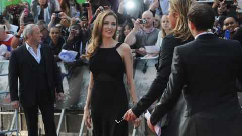 """In May 2013, Jolie announced in <a href=""""http://www.nytimes.com/2013/05/14/opinion/my-medical-choice.html"""" target=""""_blank"""" target=""""_blank"""">a New York Times op-ed </a>that she underwent a preventive double mastectomy after learning that she carries a mutation of the BRCA1 gene, which sharply increases her risk of developing breast and ovarian cancer. Here, in June 2013, she makes her first red carpet appearance since the surgery, attending the London premiere of Pitt's movie """"World War Z."""""""