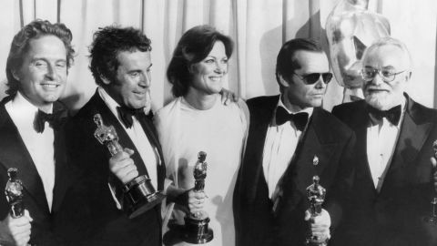 """From left, producer Michael Douglas, director Milos Forman, actress Louise Fletcher, actor Jack Nicholson and producer Saul Zaentz, hold Oscars at the 43th Academy Awards for the 1975 film, """"One Flew Over the Cuckoo's Nest."""" Douglas has been nominated for and won two Academy Awards."""