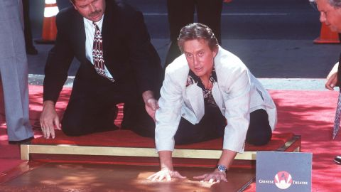 In 1997, the famed actor adds his handprints and footprints to the Hollywood Walk of Fame in California.