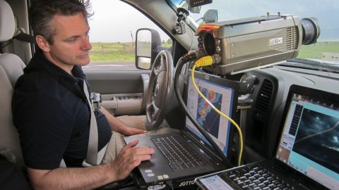 Carl Young, 45, reads data in a storm-chasing vehicle. He was a part of TWISTEX, the Tactical Weather Instrumented Sampling in Tornadoes Experiment, founded by Tim Samaras to help learn more about tornadoes and increase lead time for warnings.