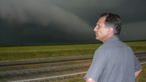 Tim Samaras looks out at storm clouds. The Weather Channel described him as a self-taught forecaster and engineer who developed much of the equipment he used to measure storms.