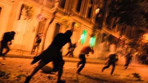 Turkish protesters clash with riot police near the prime minister's office between Taksim and Besiktas early June 3.