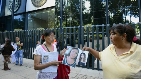 Relatives of the 12 missing youth protest in front of the general attorney's office in Mexico City on May 31.