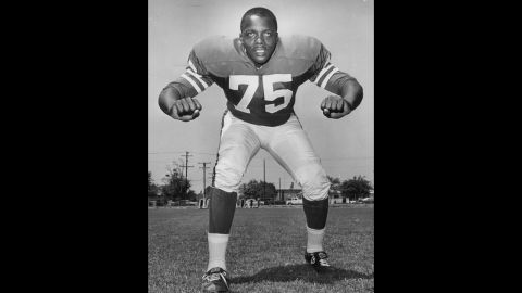 """<a href=""""http://www.cnn.com/2013/06/04/us/sport-deacon-jones-death/?hpt=us_c2"""">David """"Deacon"""" Jones</a>, credited with coining the term """"sacking the quarterback"""" during his stint as one of the NFL's greatest defensive ends, died of natural causes at his Southern California home, the Washington Redskins said Monday, June 3. He was 74. Here, the Los Angeles Rams Hall of Fame defensive end appears in the early 1960s."""