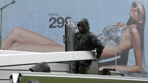 Czech soldiers erect metal barriers on the banks of the Vltava River in Prague's Holesovice district.