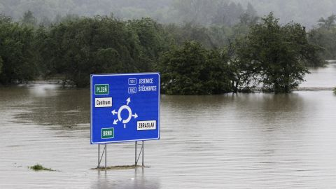 A traffic sign is surrounded by the flooded Berounka River on the outskirts of Prague on June 3.