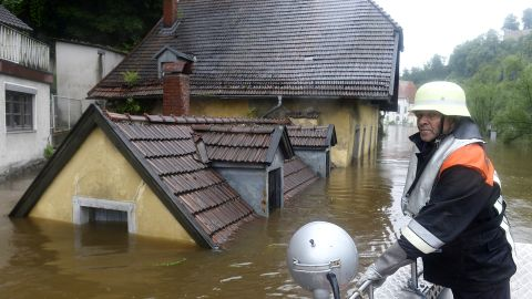 A rescuer navigates through an flooded street in Passau, Germany.