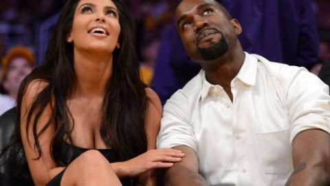 Kim Kardashian and Kanye West sit courtside at a Los Angeles Lakers game.