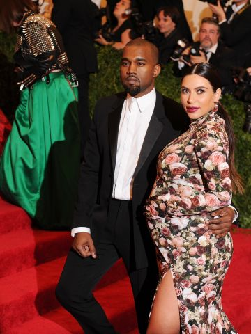"""If there were a thought bubble above Kanye's head at the 2013 Met Gala, we'd bet it would say, """"Say something about my girlfriend's dress. I dare you."""""""