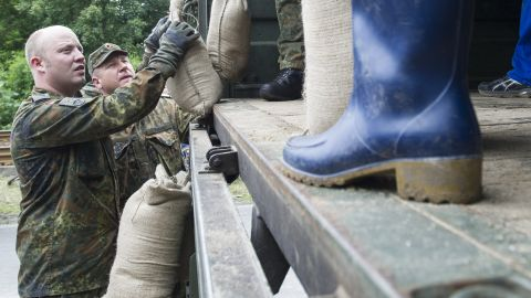 Volunteers and soldiers stack sandbags on June 4 to strengthen a dam of the rising Saale River on the outskirts in Halle, Germany.