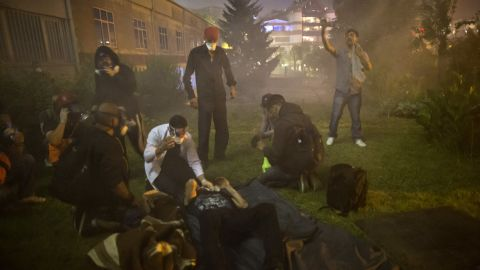 Protester wounds are treated during clashes in Istanbul on June 3.