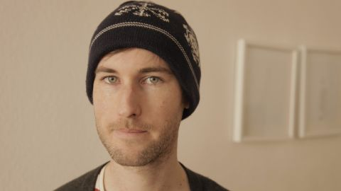 Sam Muirhead wearing his open-source woolly hat.