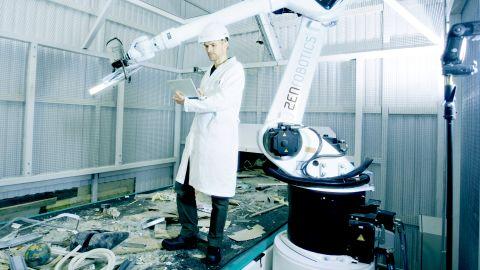 ZenRobotics Principal Scientist, Dr. Harri Valpola adjusts the robot of the ZRR system.