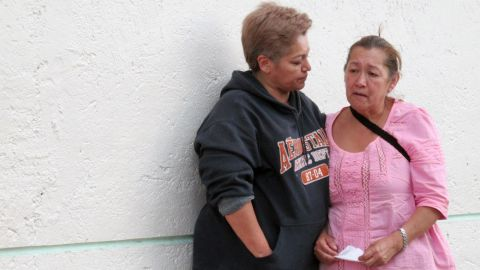 Maria Teresa Ramos, right, the grandmother of Jerzy Ortiz Ponce, is consoled by a neighbor in Mexico City on May 31.