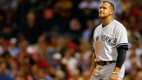 BOSTON, MA - SEPTEMBER 13: Alex Rodriguez #13 of the New York Yankees reacts after striking out in the 7th inning against the Boston Red Sox during the game on September 13, 2012 at Fenway Park in Boston, Massachusetts.  (Photo by Jared Wickerham/Getty Images)