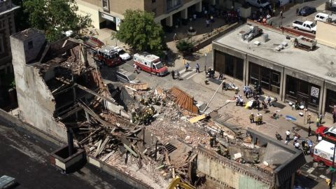 The four-story building was in the process of being demolished when it apparently fell onto a Salvation Army store about 10:45 a.m Wednesday morning.