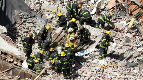 Rescue workers comb through the debris as they search for survivors.