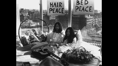 """John Lennon and Yoko Ono give a press conference during their """"bed-in"""" for peace at an Amsterdam hotel in March 1969."""