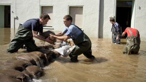 Volunteers stack sandbags as the Saale River overruns parts of Calbe, Germany, on June 6.