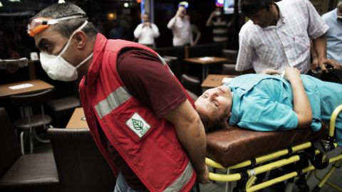 A woman is wheeled away by paramedics during clashes on Kizilay Square in Ankara on Wednesday, June 5.