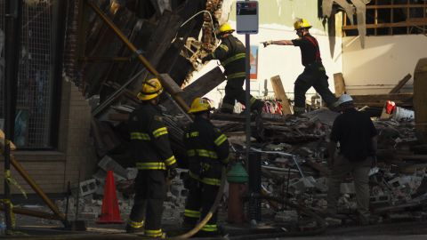 Firefighters search through the rubble of a collapsed building in Philadelphia after an apparent demolition accident on Wednesday, June 5.