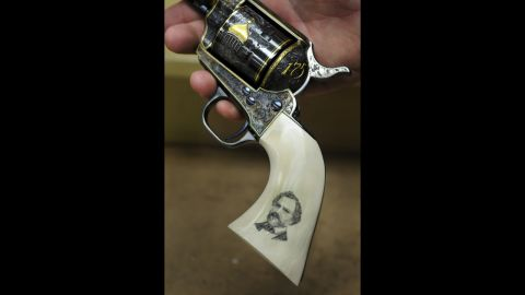 A custom Colt .45 single action, built to commemorate the company's 175th anniversary in 2012, has one-of-a-kind hand tooling and a scrimshaw handle depicting Samuel Colt.