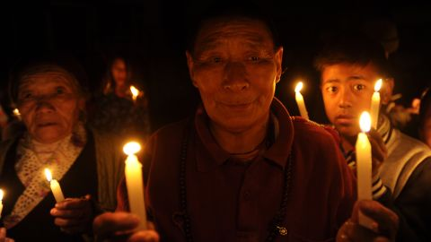 Tibetans-in-exile hold a vigil in Kathmandu, Nepal, following the self-immolation of a monk in protest against Chinese rule.
