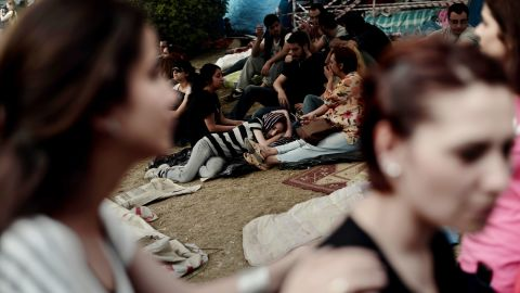Protesters rest in Gezi Park next to Taksim Square during a demonstration in Istanbul on Friday, June 7.