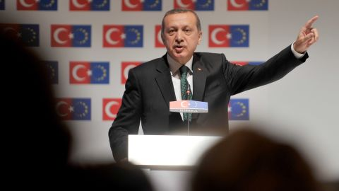 """Prime Minister Recep Tayyip Erdogan speaks during the opening session of the Ministry for European Union Affairs Conference on June 7 in Istanbul. Erdogan said today his Islamic-rooted government was open to """"democratic demands"""" and hit back at EU criticism of his government's handling of a week of unrest."""