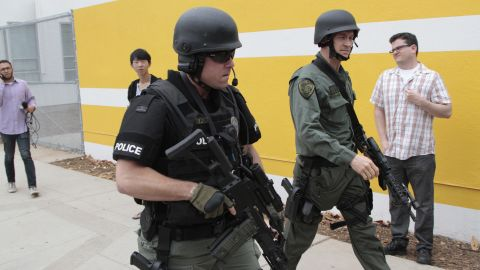 SWAT officers conduct a search at the college after the shooting.