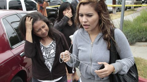 Women leave campus after the shooting.