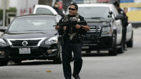 A police officer helps search the campus.