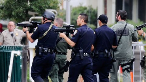 Los Angeles Police Department officers along with Los Angeles County Sheriff deputies search the campus of Santa Monica College after a reported shooting on Friday, June 7.