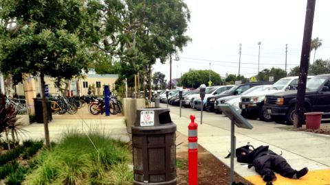 """<a href=""""http://ireport.cnn.com/docs/DOC-985090"""">iReporter Daniel Kraft </a>took this image of what he believes to be the shooter's body as Kraft was being evacuated from the campus by a SWAT team."""