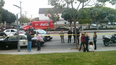 """<a href=""""http://ireport.cnn.com/docs/DOC-984881"""">iReporter Nathaniel Westveer</a> photographed the chaotic scene right outside his office building, which is 100 feet away from the crime scene at Santa Monica College. He says during the shooting, police closed down the intersection as they combed the adjacent office complex with their guns drawn."""