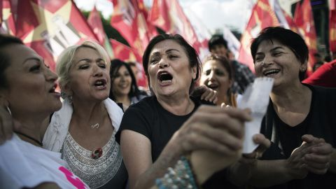 Women sing as people gather at Kizilay Square in Ankara on June 8.