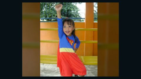 """<a href=""""http://ireport.cnn.com/docs/DOC-979832"""">Socrates Ballais</a> photographed his daughter, Iyah, dressed as """"Supergirl"""" for a school presentation. Both he and his daughter are huge superhero fans.  When Iyah wears the Superman cape, she believes she really has superpowers. """"She has no fear of heights, and thinks she is as powerful as Superman. I keep on reminding her that acting like Supergirl is just like a pretend play. She does not believe it,"""" he said. """"I had to make sure that I am around when she dons the Supergirl attire."""""""
