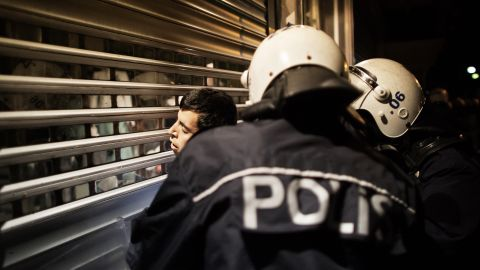 A demonstrator is detained by police officers as protests resumed in Kizilay Square in Ankara on Sunday, June 9.