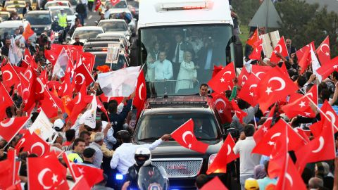 """Turkish Prime Minister Recep Tayyip Erdogan, left, and his wife, Emine, wave to supporters upon their arrival in Ankara on June 9. Erdogan told supporters that """"even patience has an end"""" as he went on the offensive against mass protests that have consumed Ankara and Istanbul."""