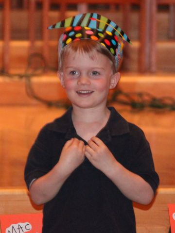 """Jill Elfering said her son <a href=""""http://ireport.cnn.com/docs/DOC-983982"""">Mac's graduation</a> from Blessed Trinity Catholic Preschool in Minneapolis was a """"precious yet simple"""" sendoff to kindergarten. The kids processed in with their paper graduation hats, and their teacher talked about the year and the students' accomplishments, highlighting their three main themes: """"I'll try,"""" I'll do my best"""" and """"I'm washable.""""  After the ceremony, there was a small reception with lemonade and Rice Krispie bars."""
