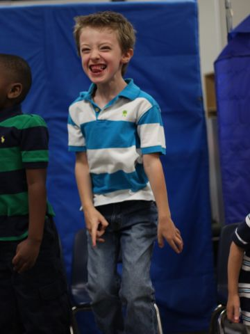 """<a href=""""http://ireport.cnn.com/docs/DOC-984449"""">Marshall Griffin</a> received the """"Best Reader"""" award at his graduation from D.P. Morris Elementary in Arlington, Texas. Part of their graduation ceremony was performing songs for the parents. In this picture, he is hopping up and down, singing one of the songs. Many of the children in his class, including Marshall, are on the autism spectrum. """"The teacher also gave a little speech about the year she's had with the children, and she cried, making all of us cry,"""" said Marshall's mom, Roni."""