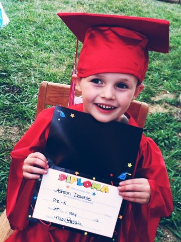"""<a href=""""http://ireport.cnn.com/docs/DOC-983716"""">Ashton Downie</a> was one of three graduates from B&B Love and Care Center in Roseville, California. After the ceremony, the preschool held an ice cream social reception and provided a bounce house for the children to play in. They had much to celebrate! This year, Ashton learned to clearly write his name (first and last), and he recognizes all upper- and lower-case letters and can count to 20."""