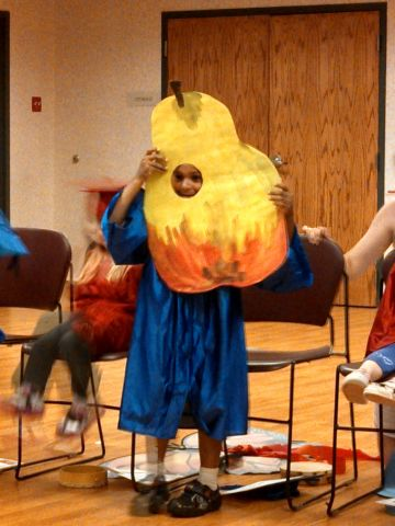"""Graduates from Creative Learning Preschool in Granby, Connecticut, performed a skit inspired by Eric Carle's """"The Very Hungry Caterpillar."""" Rachel Haywood's <a href=""""http://ireport.cnn.com/docs/DOC-986227"""">son Riley</a> played the part of the pear. """"This is their first step into their whole lives, so to speak,"""" she said of the move to kindergarten. """"They will be completely independent of their mommies and daddies for the first time."""""""