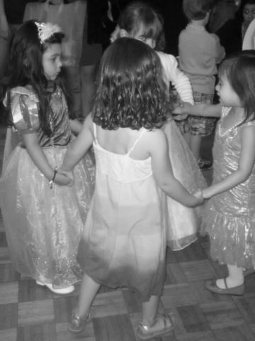 """The JCC preschoolers were also treated to a class trip to a petting zoo and a prom, where a DJ was in the Merrick Jewish Centre's ballroom playing songs such as """"Gangnam Style"""" and the No. 1 song choice for these graduates, """"Call Me Maybe.""""  An arts and crafts table and carnival-themed photobooth completed their pre-K prom experience, which was capped with ice cream sundaes and chocolate fondue treats."""