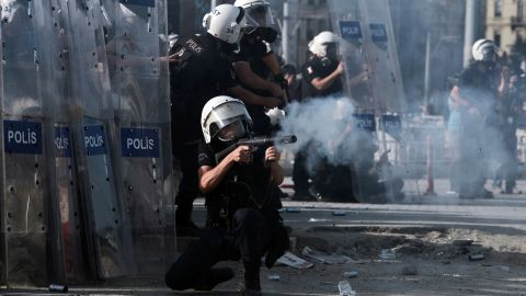 Riot police fire tear gas at demonstrators in Taksim Square on June 11.