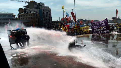 Police fire a water cannon at protesters on June 11.