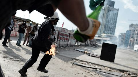 Protesters hold molotov cocktails in Taksim Square on June 11.