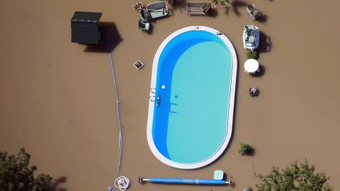Floodwaters from the Elbe River inundate a yard with a swimming pool near Magdeburg, Germany, on Monday, June 10.